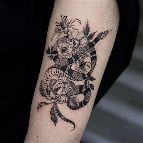 snake flowers oozytattoo blackwork tattoo