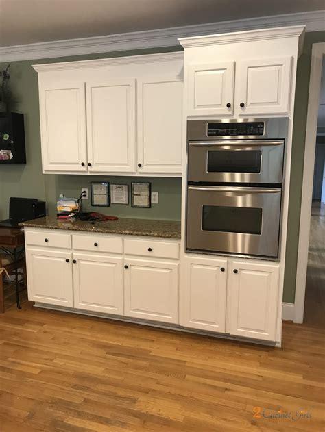 cloud white kitchen  cabinet girls
