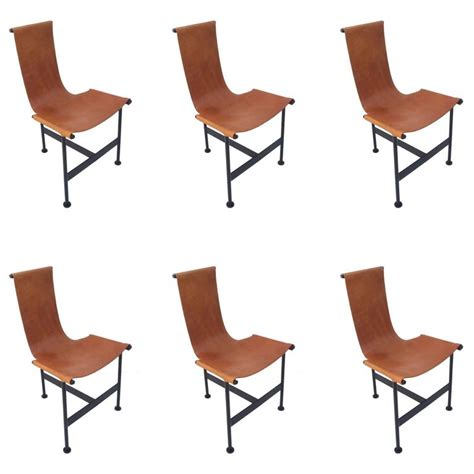 set of six 1940s leather and iron sling dining chairs at