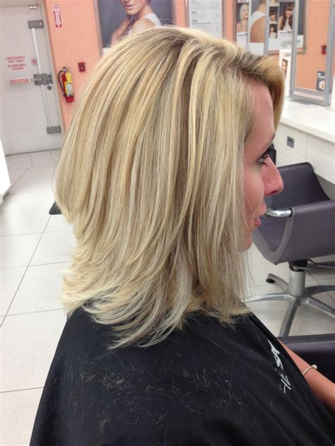 Barely there angled long bob with layers Highlighted with