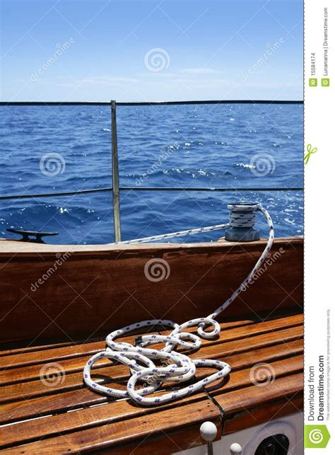 Deck Boat In Ocean by Wooden Sailboat Boat Deck Blue Sky Ocean Sea Stock Images