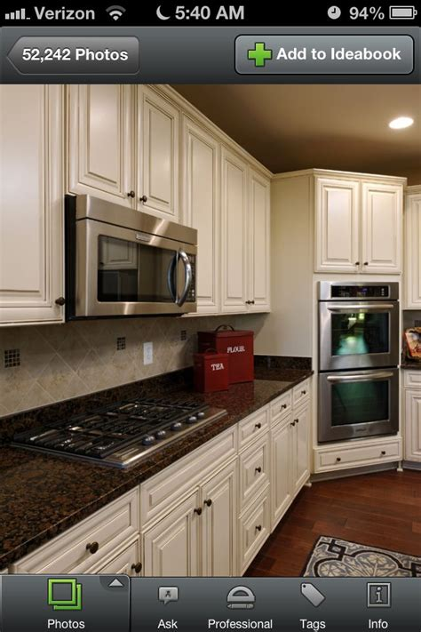 biscotti  cocoa glaze cabinets  dark brown granite