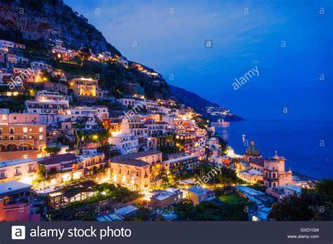 Cliff Side Buildings Illuminated At Night Positano