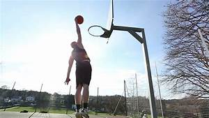 Basketball Player Slam Dunking The Ball On An Outdoor ...