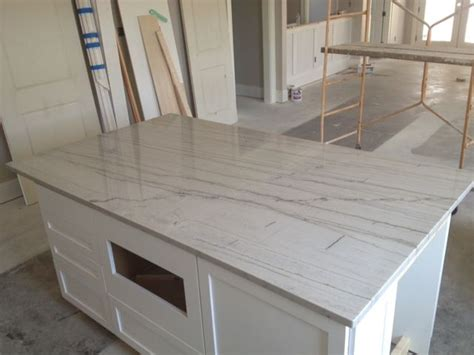 white quartzite countertops white macabus countertops backsplash