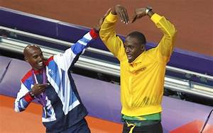 Usain Bolt does the 'Mobot' as he sets a new world record ...