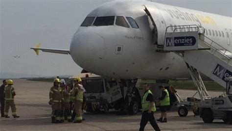 vueling airplane crushes tow truck at manchester airport stuff co nz