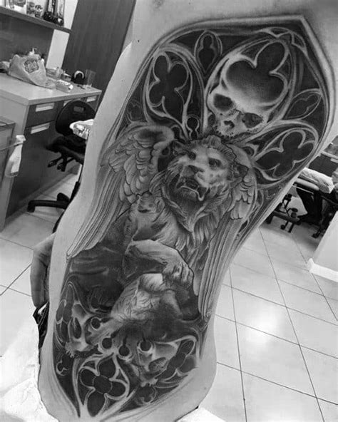 40 Lion Statue Tattoo Designs For Men - Carved Stone Ink Ideas
