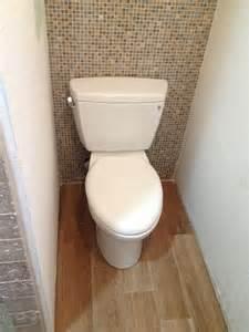 mosaic tile behind the toilet my new half bath