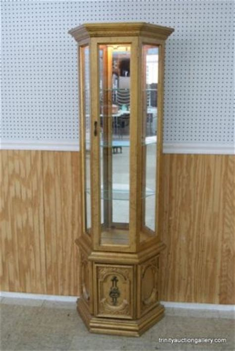 style glass cased lighted curio cabinet