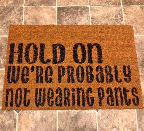 hold     wearing pants doormat
