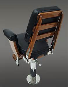 black helm chair with exposed teak back