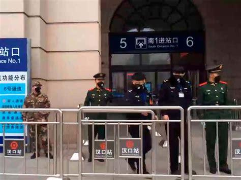China coronavirus: Swat teams guard Wuhan's train station ...
