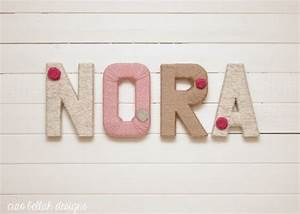 wrap plain wooden letters in yarn and decorate with With plain wooden letters