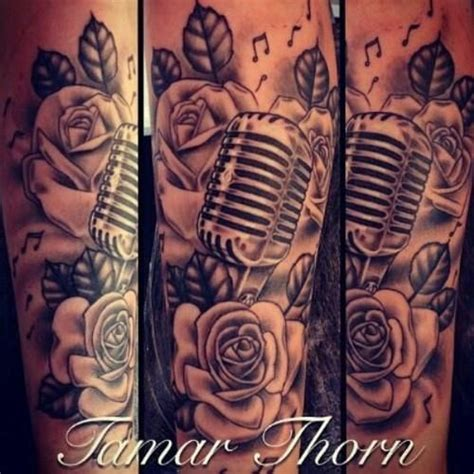 Music and Rose Sleeve Tattoos