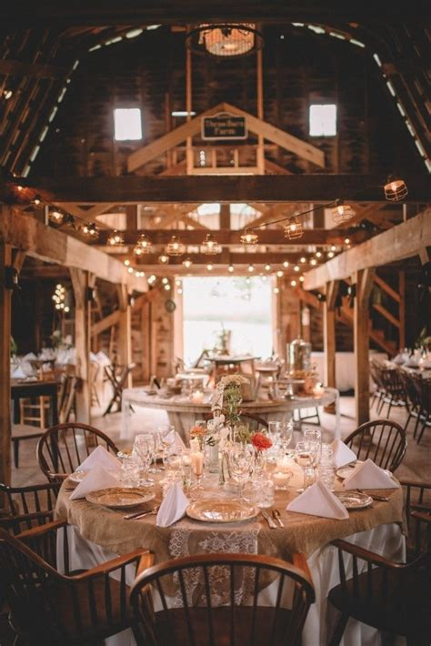 cozy barn reception  white table cloths burlap