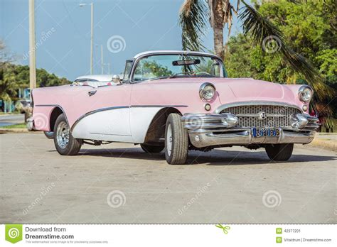 Old Vintage Pink & White Classic Car Stock Image