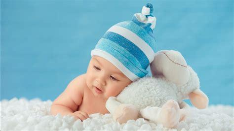 beautiful cute baby  lying   white cloth wearing
