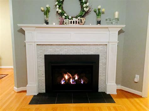 fireplace design with marble mantel and brick firebox