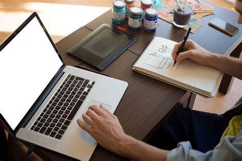 handsome hipster modern man designer working home