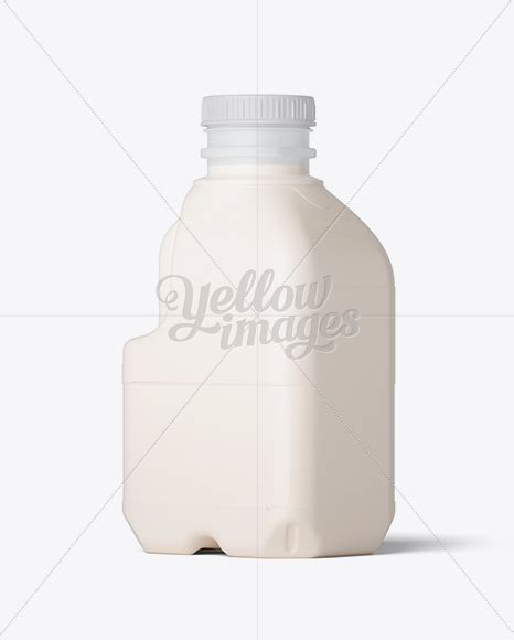 Present your design on this mockup. Download Frosted Plastic Jug With Milk Mockup - Half Side ...