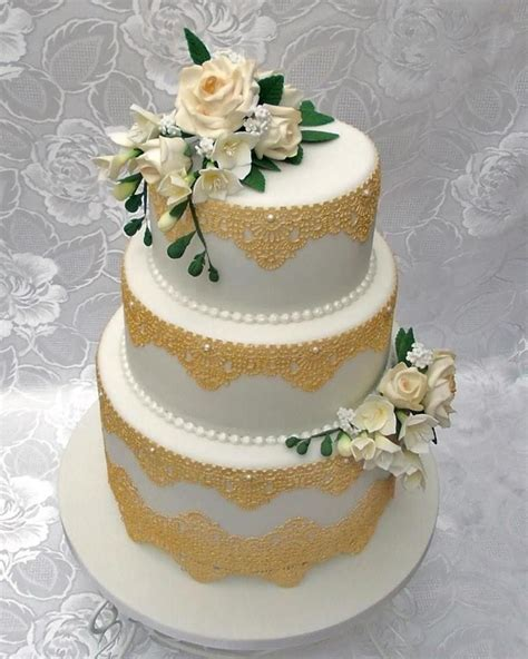 tier wedding cake  gold edible lace  hand