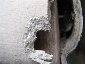 Removing Asbestos Floor Tiles by Asbestos Industry