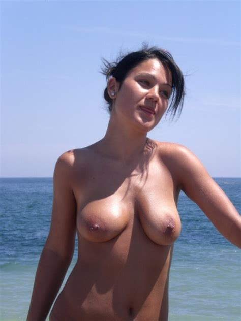 Busty milf shows her naked body at the nude beach - Pichunter