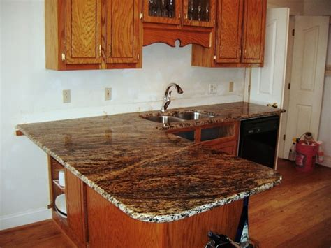 granite for oak cabinets traditional