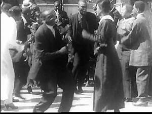 A 1914 film showing black people dancing in a dance hall ...