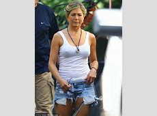 Jennifer Aniston dons ripped Daisy Dukes and tight white