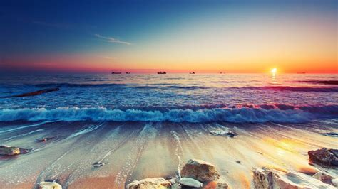 sunset sandy beach sparkling waves ultra hd  resolution