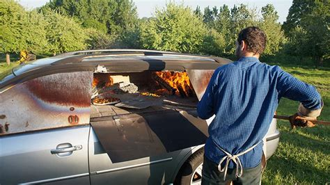 artist modded  car   woodfire pizza oven