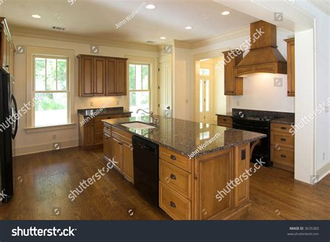 kitchen cabinets with black appliances large luxurious kitchen with maple cabinets and black Maple