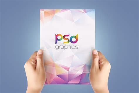 A4 Paper in Hand Mockup Free PSD PSD Graphics Free psd