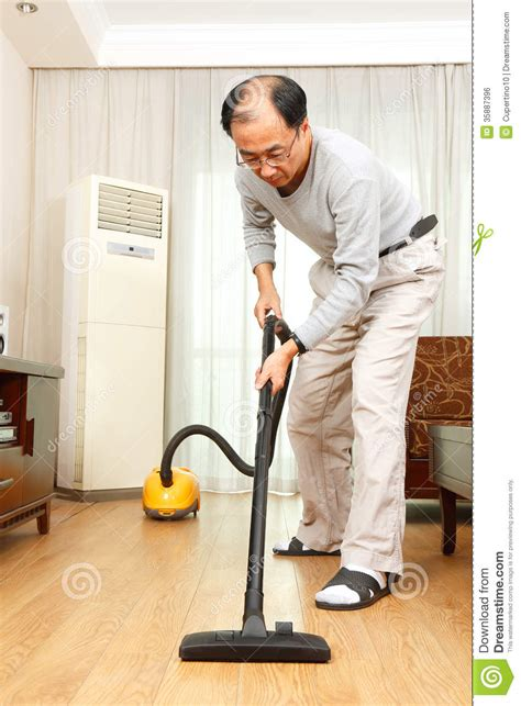 vacuuming floors man doing housework royalty free stock image image 35887396
