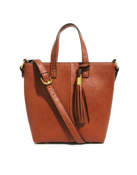 lyst asos mini tote bag  tassel detail  brown