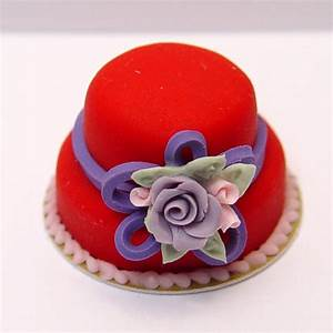 Minature Red Hat Cake w/purple rose, pink rose buds and a