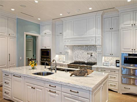 white kitchen cabinets white marble countertops