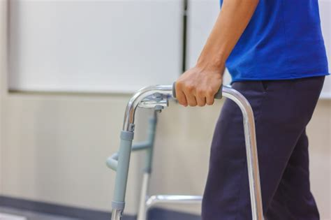 patient surgery walking physical therapist helping walker hospital walk premium walkers aged closeup practice middle male using