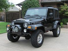 silver unlimited wrangler  rims  tires