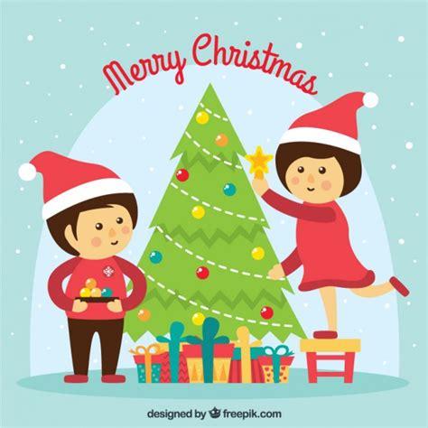 arbol de navidad para niã os los ni 241 os decorando el 225 rbol de navidad descargar vectores gratis