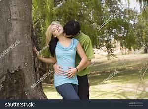 Boyfriend Kissing Girlfriend On Neck Garden Stock Photo ...
