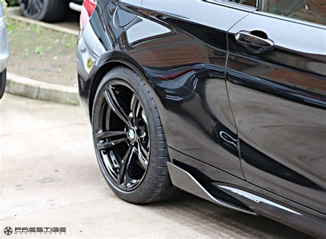 bmw f87 m2 lowered eibach springs and wheels refinished to gloss black prestige wheel centre news