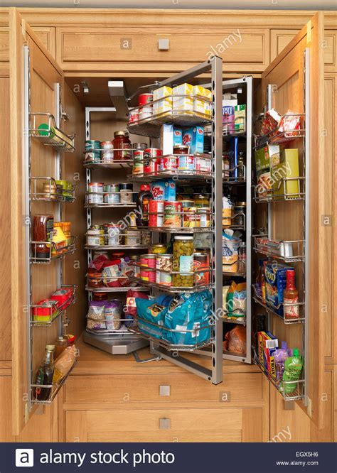 Larder with revolving storage shelves Stock Photo