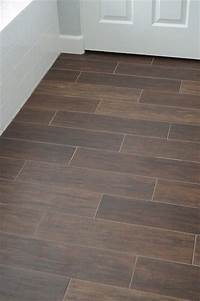 ceramic tile floor Ceramic tile that looks like wood, what a great idea for bathrooms and basement spaces. Love it ...
