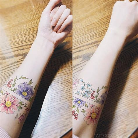 tattoosorg flower arm band tattoo artist