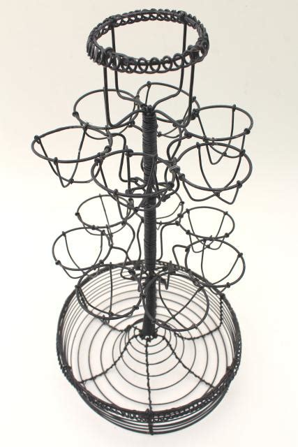 primitive wire basket egg holder tall stand rack  bowl  kitchen table  counter