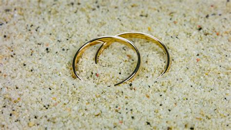 Wedding Rings In Sand On Tropical Beach Stock Footage
