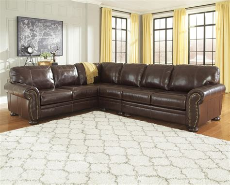 sectional sofa with nailhead trim signature design by ashley banner 3 piece leather match